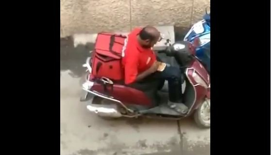 Zomato delivery man eating ordered food