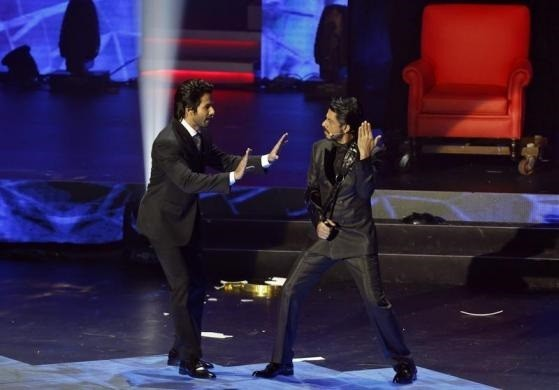 Bollywood actors Shah Rukh Khan (R) and Shahid Kapur