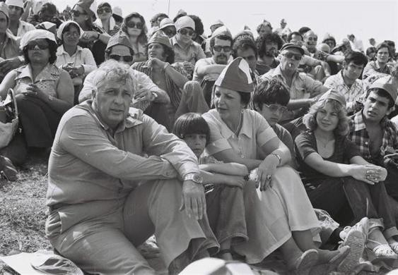 riel Sharon (L) sits with his wife Lily (3rd L) and his sons, Gilad (2nd L) and Omri (4th L) during an event to launch his new political party, Shlomzion, in the West Bank in this picture taken in 1977