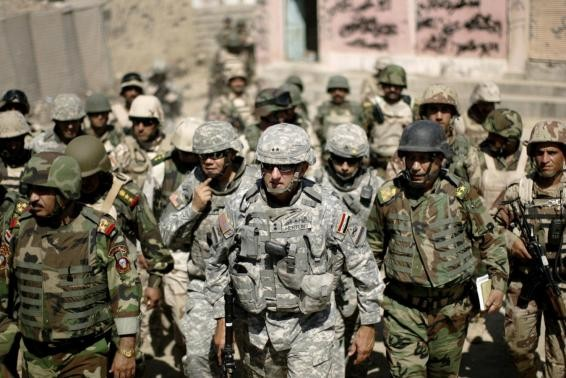 Major-General Mark Hertling (C), the commander of the U.S. forces in northern Iraq, walks during a battlefield circulation patrol on the streets in Mosul in June 19, 2008 file photo.