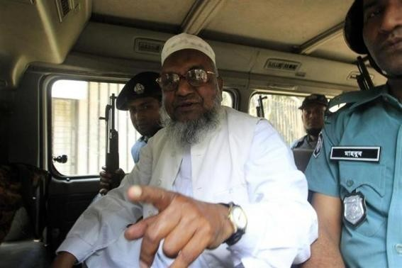 Bangladesh's Jamaat-e-Islami leader Abdul Quader Mullah gestures as he talks from a police van after a war crimes tribunal sentenced him to life imprisonment in Dhaka in this file photo. (Reuters)
