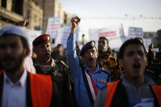 Army and police officers loyal to the Houthi movement shout slogans as they take part in a demonstration to show support to the movement in Sanaa January 23, 2015.