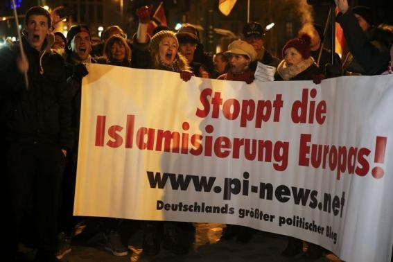 People take part in a march of a grass-roots anti-Muslim movement in Germany.