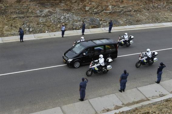 The funeral cortege carrying the coffin of former South African President Nelson Mandela drives through Mandela's homeland just outside the village of Qunu December 14, 2013