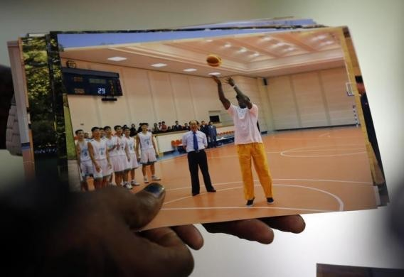 Dennis Rodman shows a picture of himself during his visit to North Korea as he arrives at Beijing Capital International Airport September 7, 2013. REUTERS