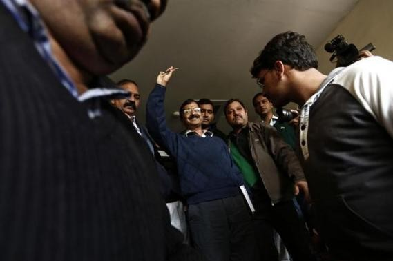 Arvind Kejriwal (C), chief of the Aam Aadmi (Common Man) Party (AAP), leaves after addressing the media during a news conference in New Delhi.