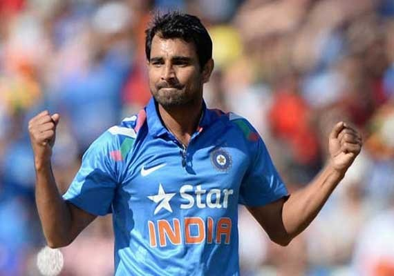 Mohammed Shami posses with his new born daughter,Mohammed Shami with his new born daughter,Mohammed Shami,cricket player Mohammed Shami,Mohammed Shami pics,Mohammed Shami images,Mohammed Shami photos,Mohammed Shami stills,Mohammed Shami pictures