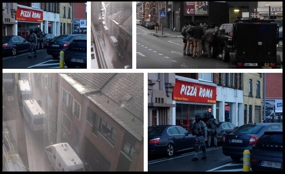 Counter Terrorism units wait out at the neighbourhood in Belgium,where four armed men have taken a man hostage.