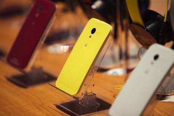 Different Colored Examples of Motorola's New Moto X Phones Rest on a Table at a Launch Event in New York