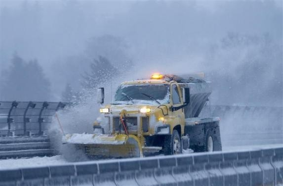 A snow plow clears the road of snow along the New York State Thruway Interstate 87 in Tarrytown, New York