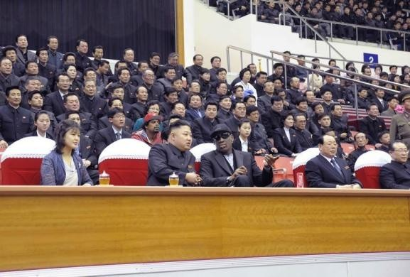 North Korean leader Kim Jong-Un (2nd L), his wife Ri Sol-Ju (L) and former NBA player Dennis Rodman (3rd L) watch an exhibition basketball game in Pyongyang