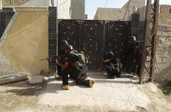Members of the Iraqi security forces patrol an area near the borders between Karbala Province and Anbar Province