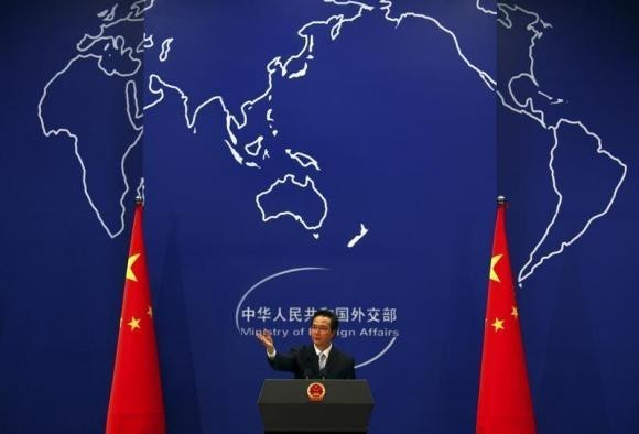 China's Foreign Ministry spokesman Hong Lei asks journalists for questions during a news conference in Beijing