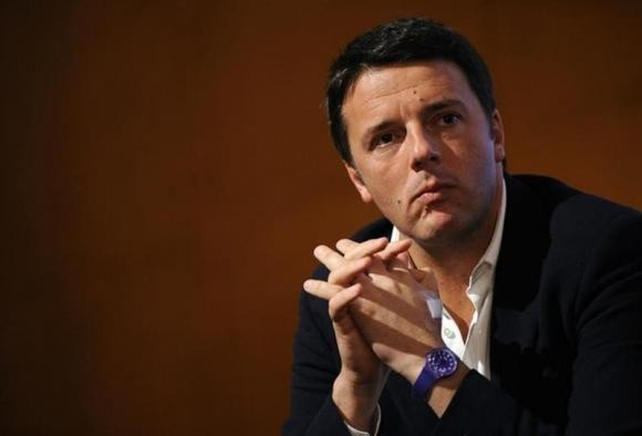 Matteo Renzi looks on during a political meeting in Turin