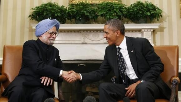 U.S. President Barack Obama shakes hands with Manmohan Singh in the Oval Office of the White House in Washington (Reuters file)