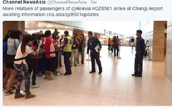 Relatives of the passengers of the missing plane arrive at the Changi airport in Singapore.