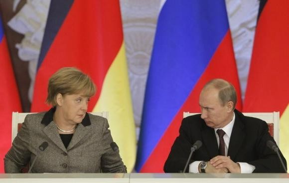 Germany's Chancellor Angela Merkel and Russian President Vladimir Putin