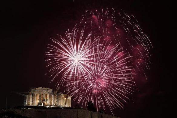 Fireworks explode over the temple of the Parthenon during New Year celebrations in Athens