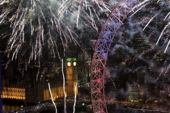 Fireworks explode across the skyline near the London Eye during New Year celebrations in London