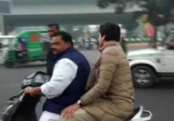 Lucknow: Congress General Secretary Priyanka Gandhi Vadra being driven on a scooty by party leader Dheeraj Gurjar after the police tried to block her way to the retired activist IPS officer S R Darapuri's residence, in Lucknow on Dec 28, 2019. Priyanka's
