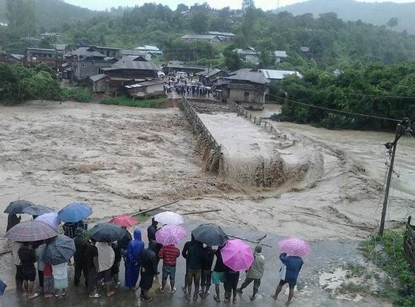 Manipur floods,Manipur,North East,Manipur flood photos,Manipur landslides,Manipur rains,rain photo,flood photo,raining,disaster,north east photos,India