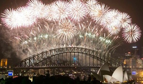 Fireworks explode over Sydney Harbour at midnight, ushering in the new year, in Sydney [Reuters]