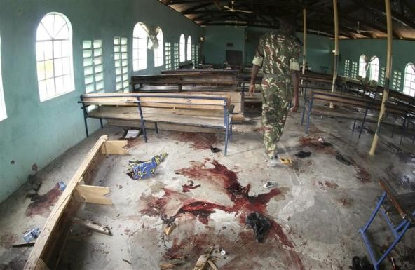 A Kenyan policeman walks inside the African Inland Church after an attack in Kenya's northern town of Garissa July 1, 2012