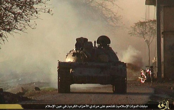 ISIS military tanks attacking Kurdish position inside Kobane from area near Turkey