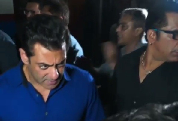 Salman Khan being pulled by female fan