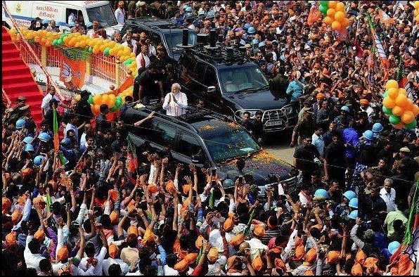 Narendra Modi,Narendra Modi road show,Narendra Modi road show at Varanasi,Narendra Modi  at Varanasi,Narendra Modi arrives for road show