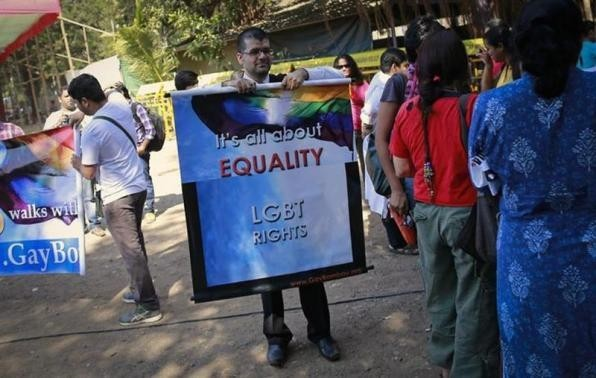 A gay rights activist holds a banner in protest of the Supreme Court ruling in Mumbai