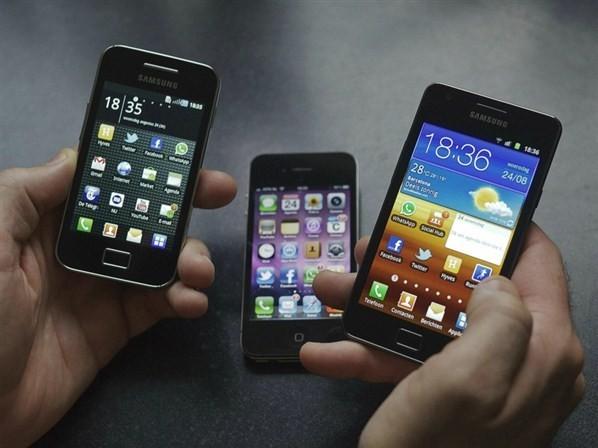 consumer comparing smartphones