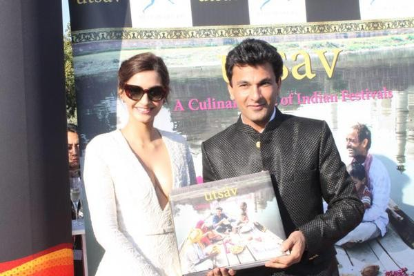 Sonam Kapoor launches Chef Vikas Khanna's book at Cannes,Sonam Kapoor,actress Sonam Kapoor,Sonam Kapoor at cannes,Sonam Kapoor at cannes 2015,Sonam Kapoor hot pics,hot Sonam Kapoor,Vikas Khanna's book,Cannes,Cannes Film Festival 2015,Cannes Film Festival