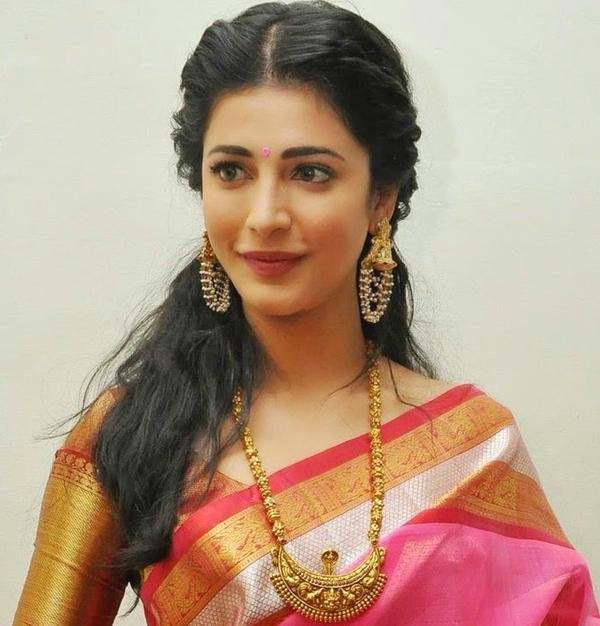 Actress Shruti Haasan,Uttama Villain music release photos,father Kamal Hassan,Shruti Uttama Villain music release,Uttama Villain Telugu audio launch pictures