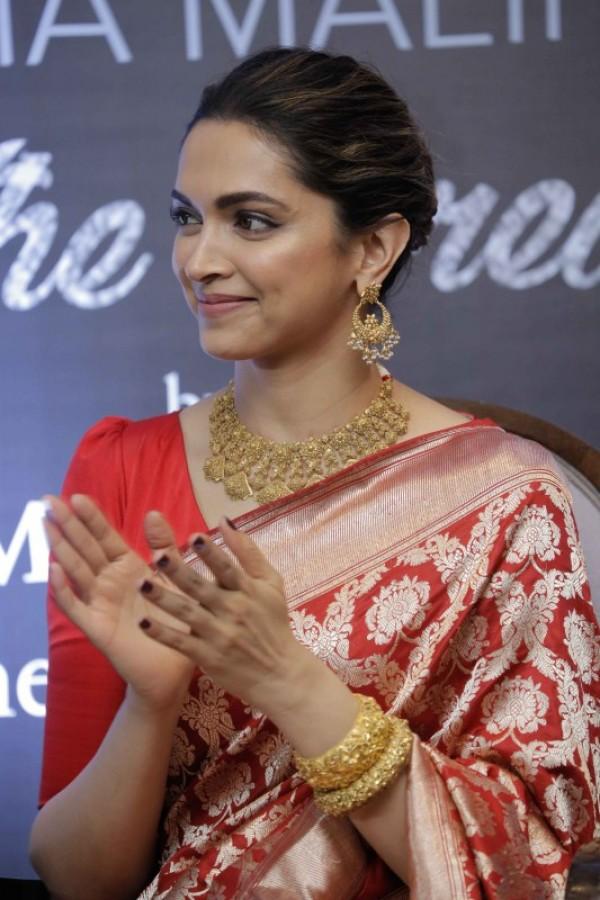 Deepika Padukone launches Hema Malini's biography Beyond ...