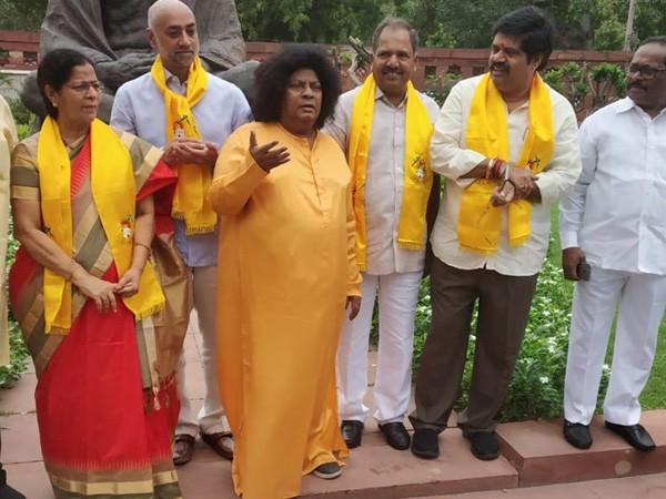 Telegu Desam Party,TDP MP Naramalli Sivaprasad,MP Naramalli Sivaprasad,Naramalli Sivaprasad,Naramalli Sivaprasad as Sathya Sai,Naramalli Sivaprasad in Sathya Sai avatar,Sathya Sai avatar,Sathya Sai Baba