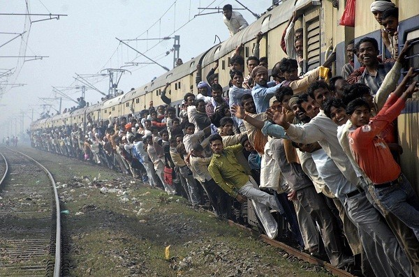 Passengers travel in an overcrowded train in the eastern Indian city of Patna.