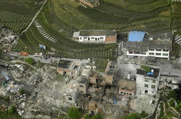 An aerial view shows houses damaged after a strong earthquake in Lushan county, Ya'an.