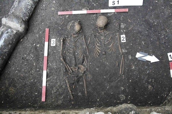 The skeletons of a man and woman buried holding hands are seen in a graveyard in Cluj-Napoca. (Reuters)