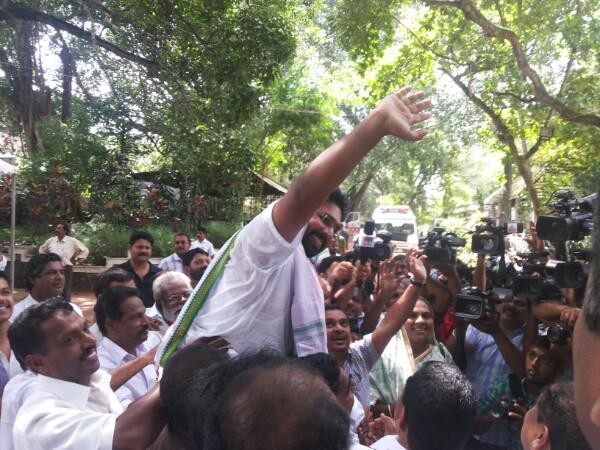 KS Sabarinathan celebrates his victory with his followers in Aruvikkara