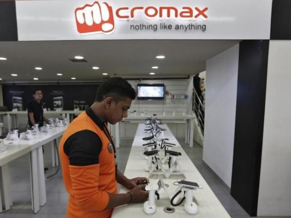 An employee stands at the counter of Micromax mobile phones at a showroom in New Delhi