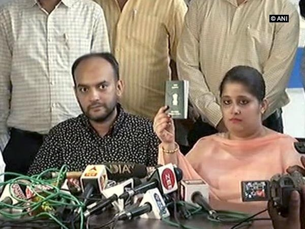 Tanvi Seth flashing her passport after being harassed by an officer at the Lucknow Regional Passport Office