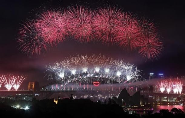Fireworks explode over and around the Sydney Harbour Bridge and Sydney Opera House during new year celebrations