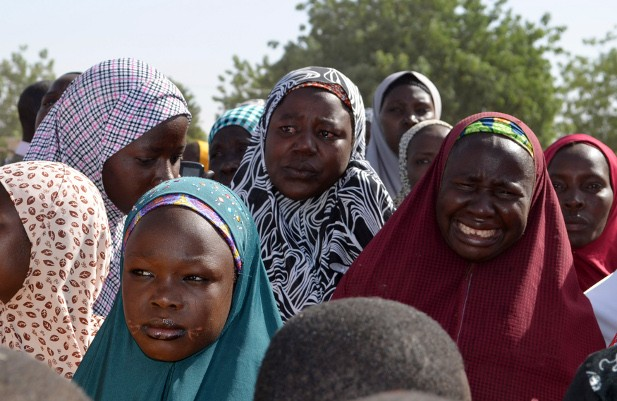Mothers of kidnapped school girls react during a meeting with the Borno State governor in Chibok, Maiduguri, Borno State, April 22, 2014.
