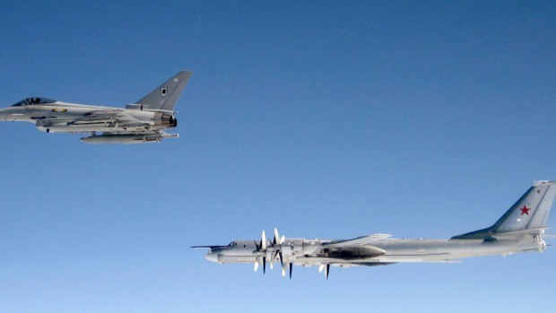 A British RAF Typhoon shadows a Russian Bear-H bomber