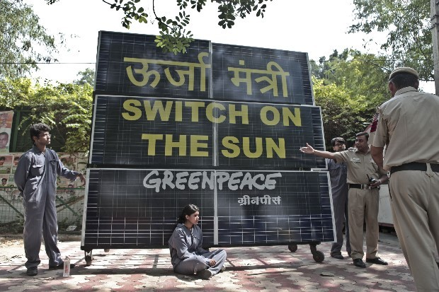 Activists set-up solar panels and chained themselves to it outside Delhi's then-power minister, Haroon Yusuf's house in 2013.