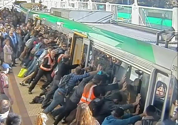 Passengers push train to save man trapped under it