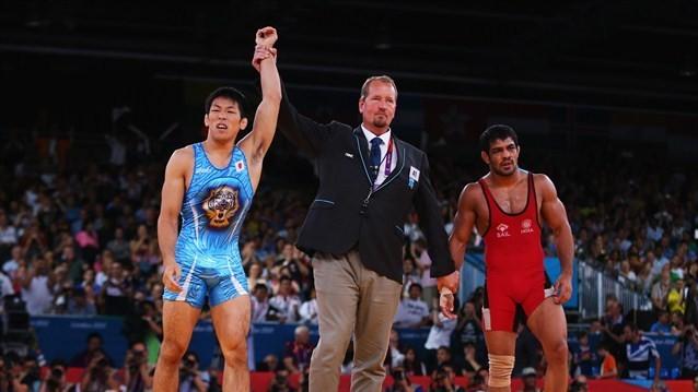 Tatsuhiro Yonemitsu of Japan celebrates his victory