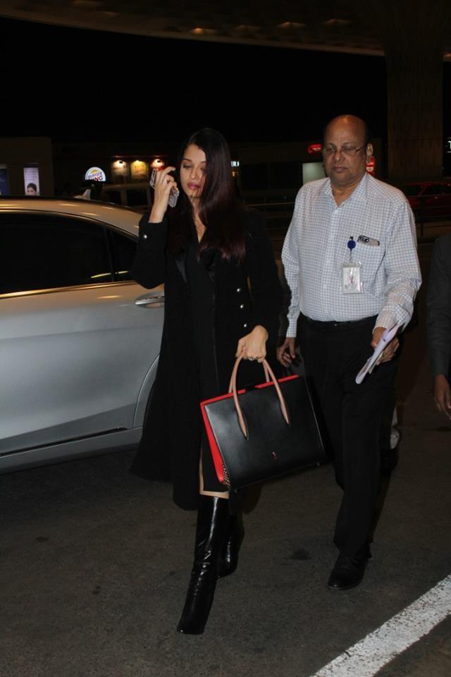 Aishwarya Rai Bachchan,Aishwarya Rai Bachchan in Black dress,Aishwarya Rai in Black dress,Aishwarya Rai returns from Dubai,Aishwarya Rai snapped at Mumbai airport,Aishwarya Rai snapped at airport