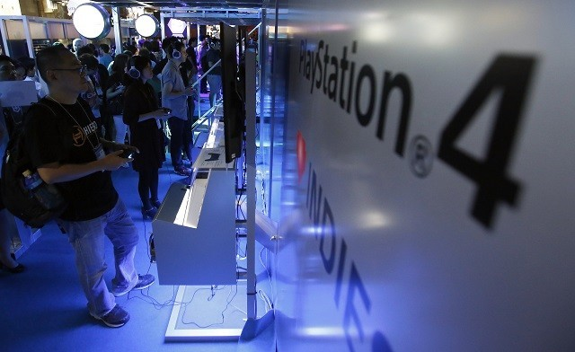 Visitors try out PlayStation 4 console at the Tokyo Game Show
